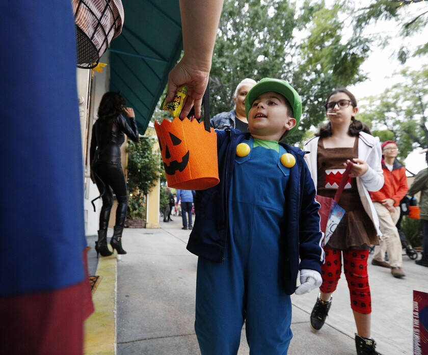 Daniel Nazaryan of Tujunga collects candy at the Montrose Trick-or-Treat Spooktacular in October 2017.