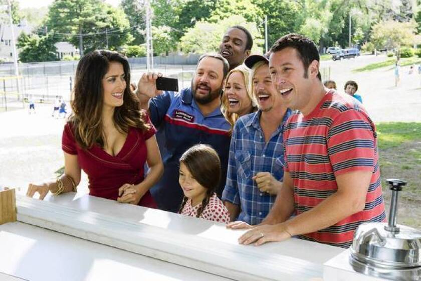 "Salma Hayek, left, Kevin James, Alexys Nicole Sanchez, Chris Rock, Maria Bello, Adam Sandler and David Spade star in ""Grown Ups 2."""
