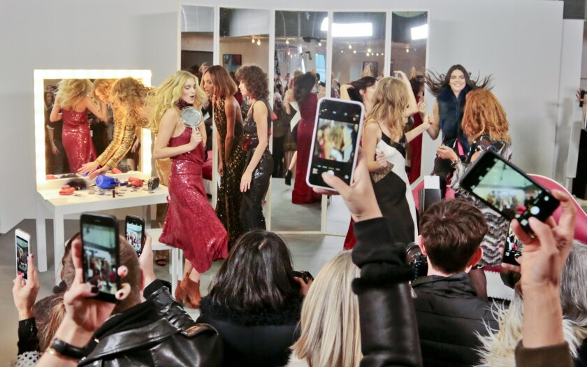 Fashion from Diane von Furstenberg Fall-Winter 2016 collection is modeled in a presentation of lively staging, during Fashion Week on Sunday, Feb. 14, 2016, in New York. (AP Photo/Bebeto Matthews)