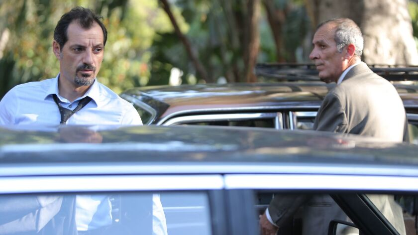 "(L-R) - Adel Karam as 'Toni' and Kamel El Basha as 'Yasser' in a scene from the movie ""The Insult."""