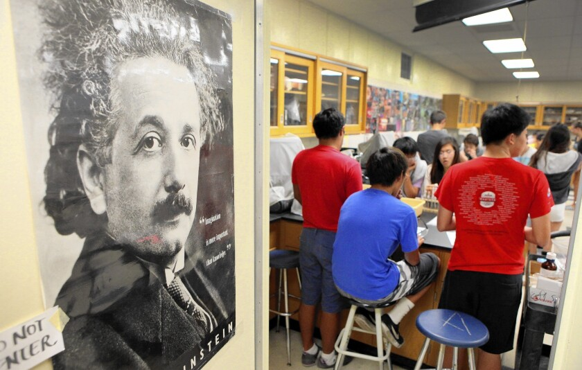 A poster of Albert Einstein hangs on a door at Peninsula High School, where Julie Maemoto teaches a summer biology class offered by the Peninsula Education Foundation.