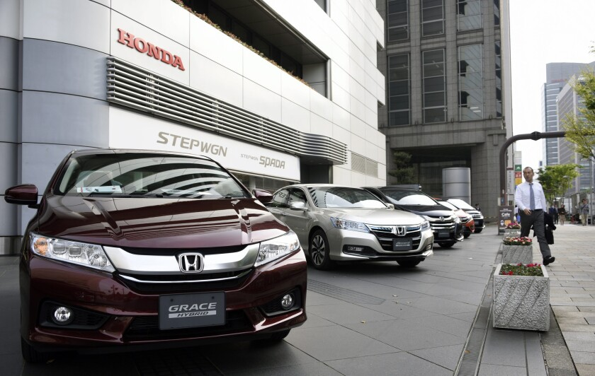 Honda vehicles are displayed before the automaker's headquarters in Tokyo on April 28.