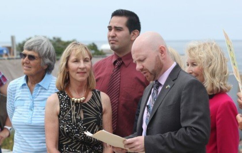 The newly christened Seal Conservancy of San Diego group (formerly Friends of La Jolla Seals) met on the sidewalk above Children's Pool/Casa beach Wednesday to draw some last-minute support for the pupping season closure before Thursday's California Coastal Commission hearing. Pat S