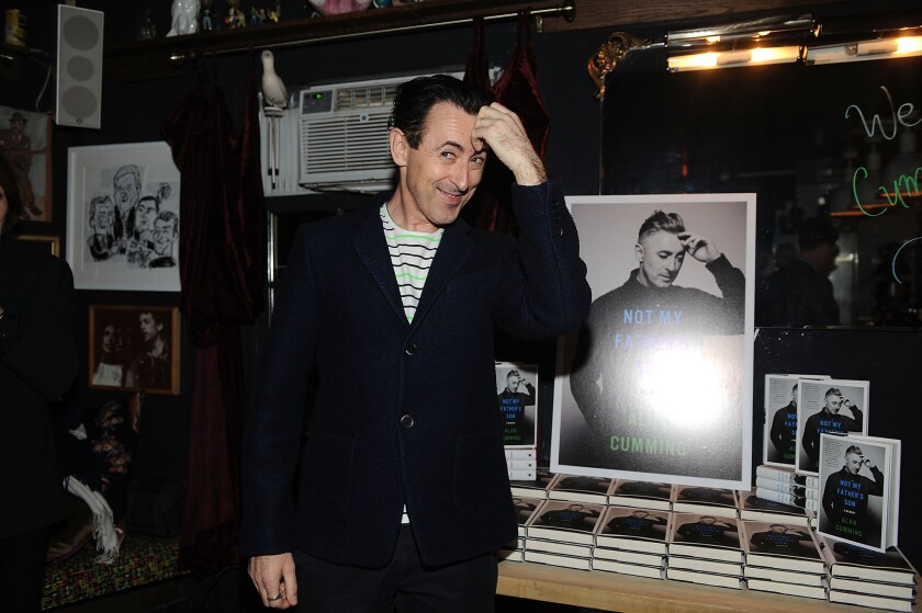 "Actor Alan Cumming posing at the book launch party for ""Not My Father's Son."""