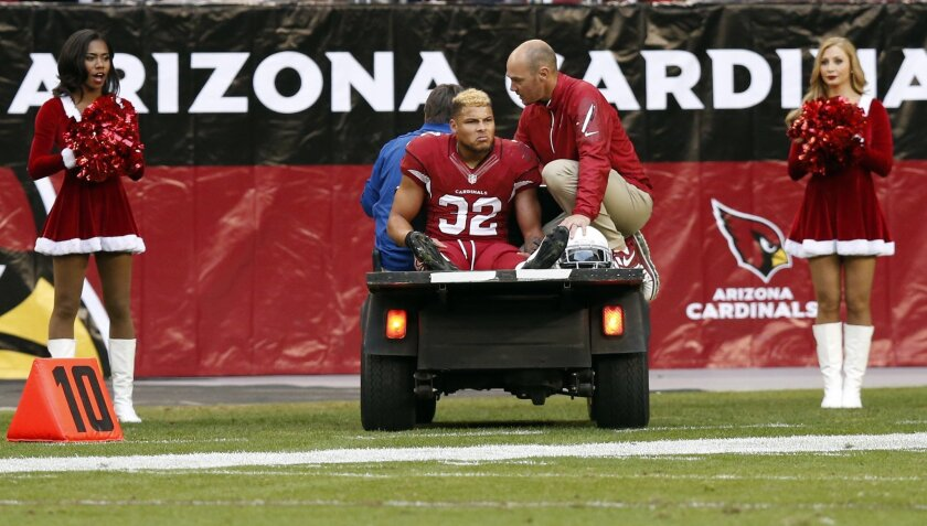 Arizona Cardinals free safety Tyrann Mathieu (32) is carted off the field after being injured during the second half of an NFL football game against the St. Louis Rams, Sunday, Dec. 8, 2013, in Glendale, Ariz. (AP Photo/Ross D. Franklin)