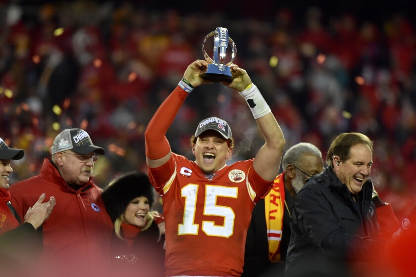 Chiefs quarterback Patrick Mahomes raises the Lamar Hunt Trophy after winning the AFC championship game on Jan. 19 at Arrowhead Stadium.
