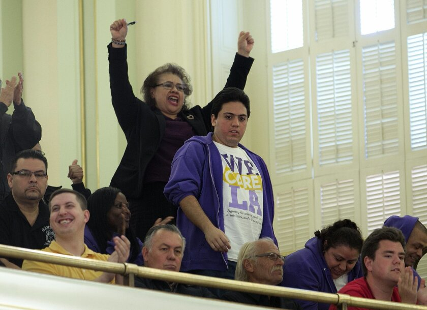 Supporters of a bill to raise California's minimum wage, celebrate in the Assembly gallery after the measure was approved by the state Assembly Thursday, March 31, 2016, in Sacramento, Calif. The proposal now moves on to the state Senate for consideration .(AP Photo/Rich Pedroncelli)