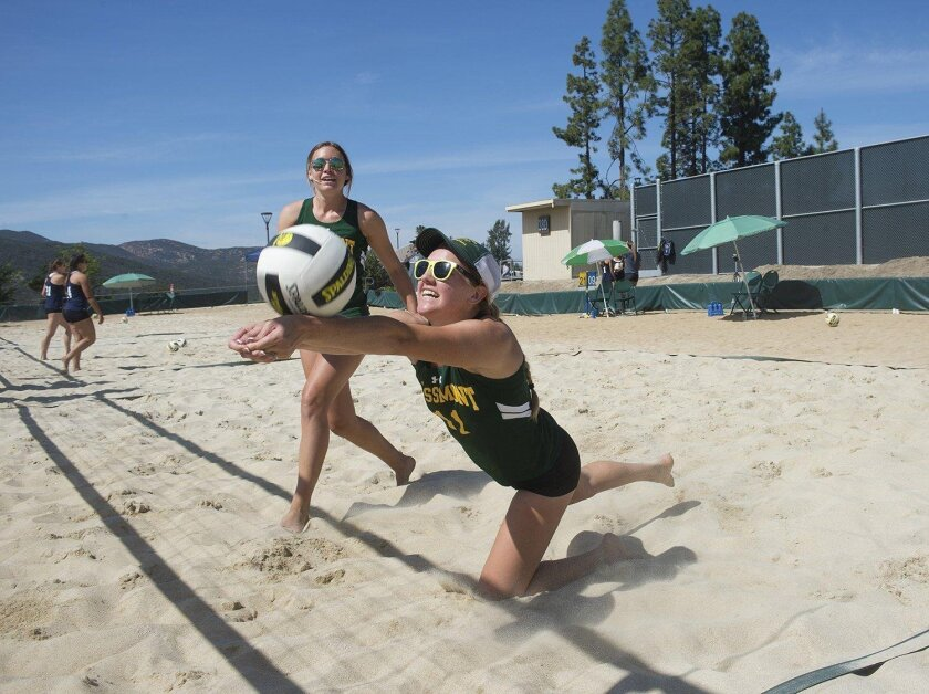 Two members of the Grossmont College women's beach volleyball team warm up for a match. With a perfect 24-0 season, the Griffins won statewide and conference titles this year, contributing to the college earning the Chet DeVore Award for the 2015-16 academic year.