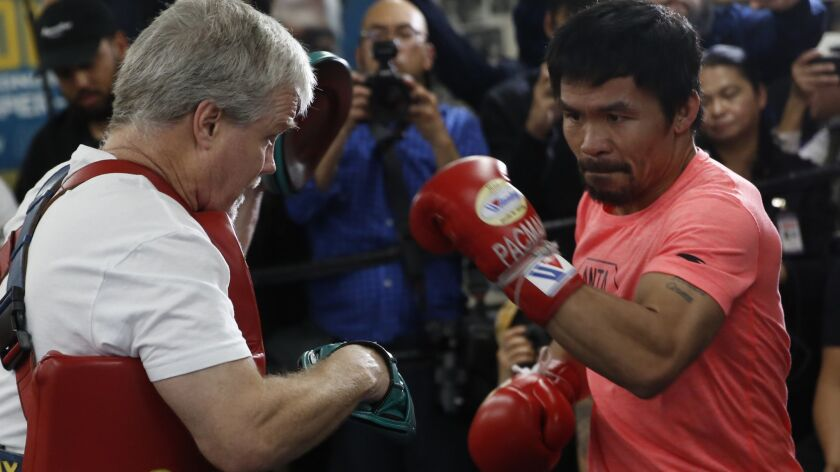 Manny Pacquiao, right, works out with trainer Freddie Roach at a boxing club in Los Angeles on Wednesday, Jan. 9, 2019. Pacquiao is scheduled to defend his WBA welterweight title against Adrien Broner on Jan. 19 in Las Vegas.