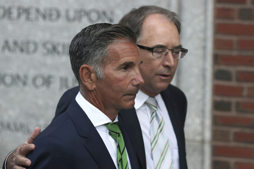 Mossimo Giannulli departs federal court in Boston after facing charges in a the college admissions bribery scandal.