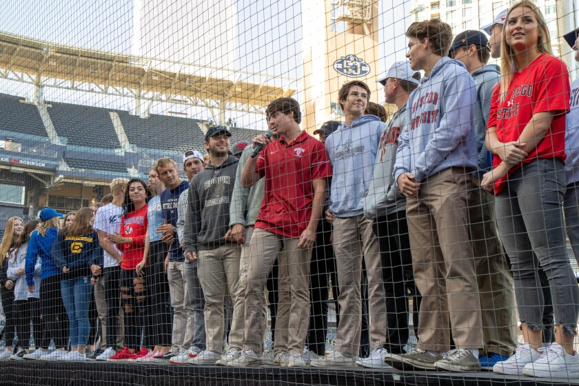 Torrey Pines athletes crowd the stage at Petco Park.