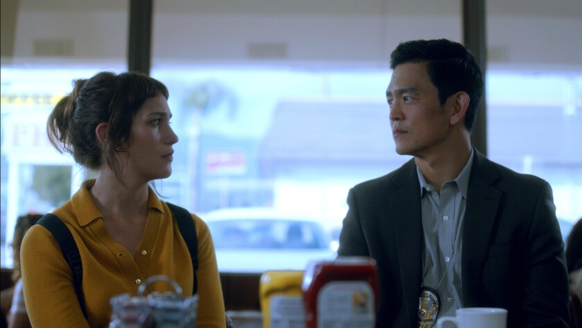 "(L-R) - Jill (Lola Kirke) and Detective Ahn (John Cho) in a scene from ""Gemini."" Credit: NEON"