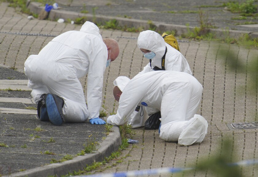 Forensic officers working at site of mass shooting