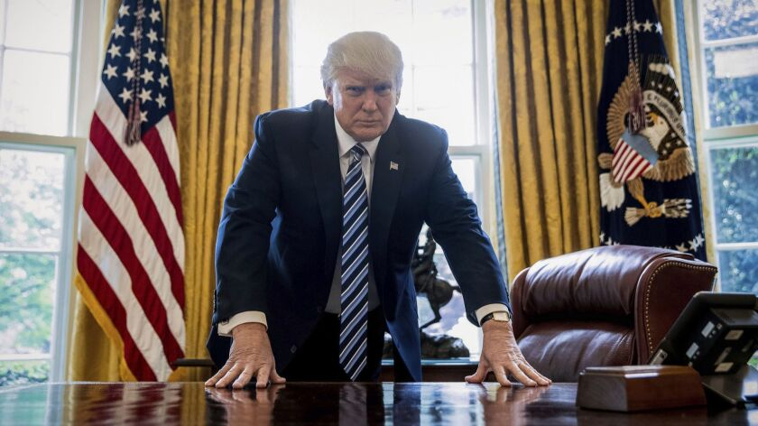 President Trump poses for a portrait in the Oval Office in Washington on April 21, 2017.
