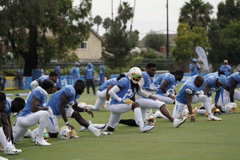 Chargers players stretch during practice.
