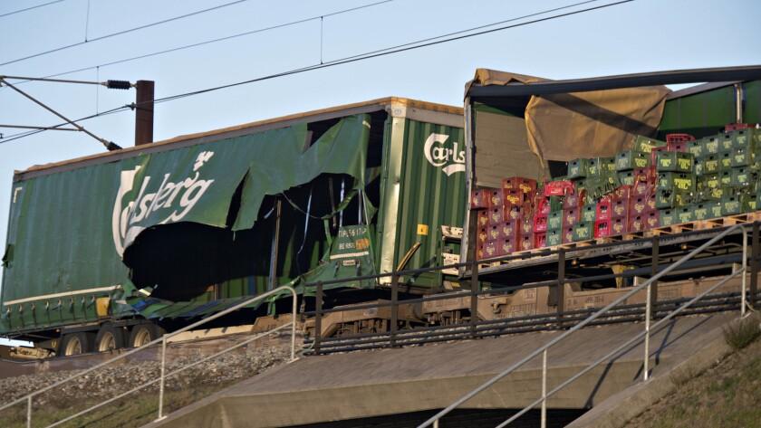 Damaged compartments of a cargo train near the Storebaelt bridge, near Nyborg in Denmark, Wednesday,