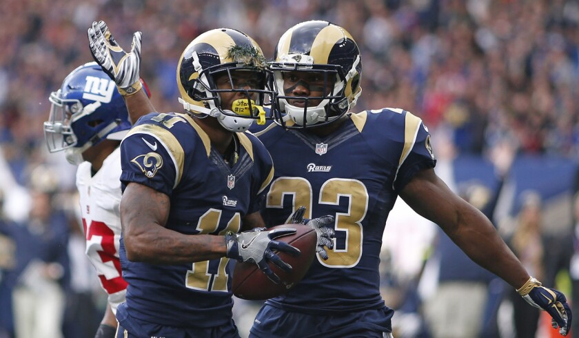 The Rams' Tavon Austin, left, celebrates his touchdown with teammate Benjamin Cunningham during the NFL International Series game between Los Angeles and the New York Giants on Sunday in London.