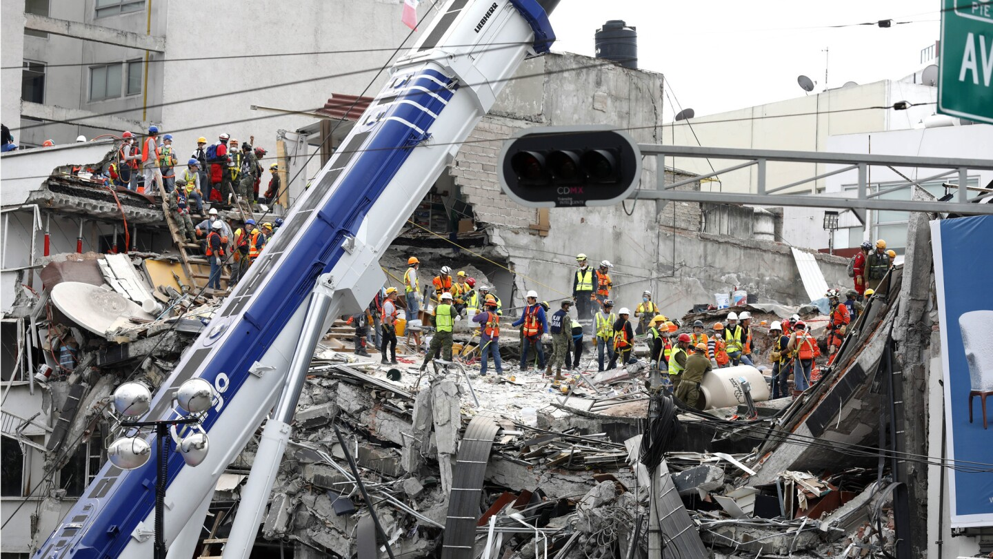 The search continues for victims buried under the rubble of a fallen office building along Calle Alvaro Obregon in La Condesa neighborhood of Mexico City.