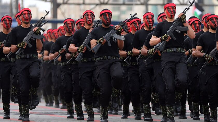 epa05879459 New members of the Palestinian Hamas security forces march as they take part in a gradua