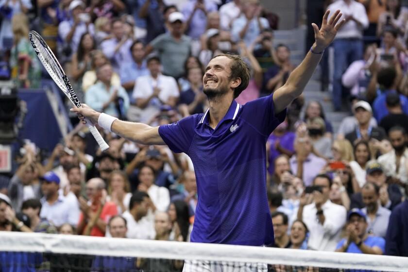 Daniil Medvedev reacts after defeating Novak Djokovic during the men's singles final