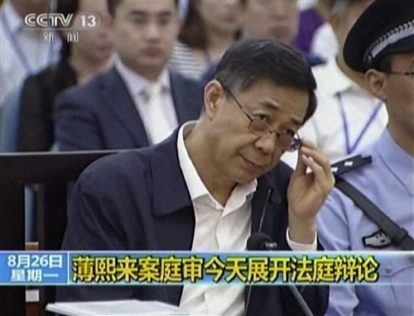 Purged Chinese politician Bo Xilai in a video from his trial in Jinan Intermediate People's Court in Shandong province.