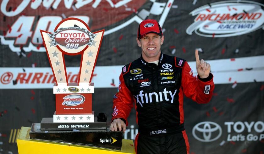 Carl Edwards wins NASCAR's Toyota Owners 400, bumping Kurt Busch near the finish