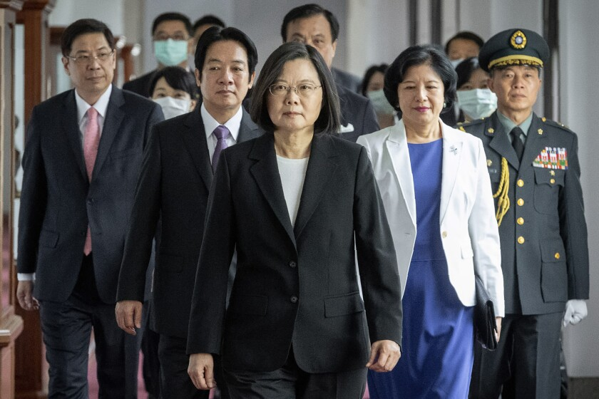 Taiwanese President Tsai Ing-wen, center, and other officials head to her May 2020 inauguration ceremony in Taipei.
