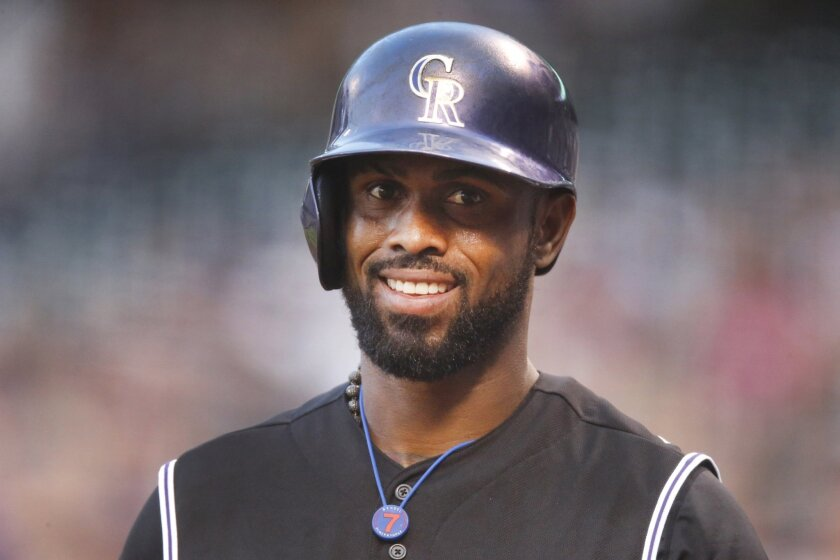FILE - In this Aug. 21, 2015, file photo, Colorado Rockies shortstop Jose Reyes is seen in the first inning of a baseball game in Denver. Reyes was arrested after an argument with his wife turned physical at the Four Seasons Resort in Wailea, Maui, on Oct. 31. Maui police say in a statement Reyes' wife was treated by medics at the scene then transported to a nearby hospital for treatment. (AP Photo/David Zalubowski, File)