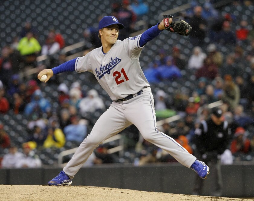 Los Angeles Dodgers starting pitcher Zack Greinke (21) delivers to the Minnesota Twins during the first inning of a baseball game in Minneapolis, Wednesday, April 30, 2014. (AP Photo/Ann Heisenfelt)