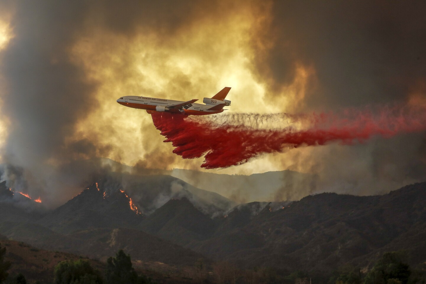 An air tanker fights the Holy fire, which forced more evacuations of neighborhoods in the Lake Elsinore area Wednesday.
