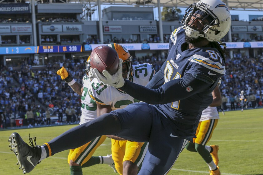 Chargers quarterback Philip Rivers flips the ball to running back Melvin Gordon.