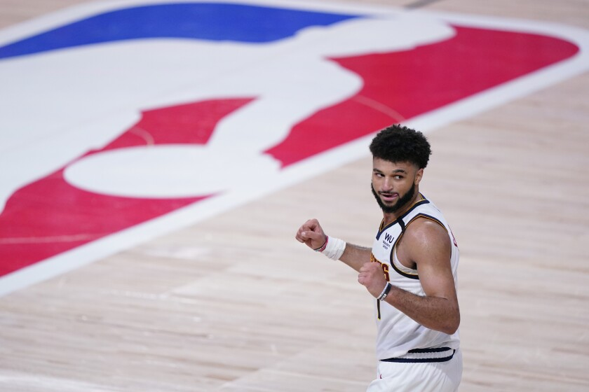 Jamal Murray celebrates the Nuggets' Game 7 win over the Clippers on Sept. 15, 2020.