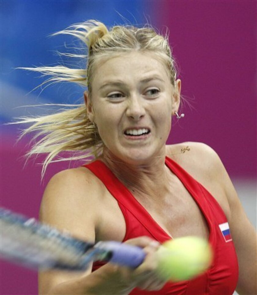 Russia's Maria Sharapova returns the ball to Spain's Silvia Soler-Espinosa during their Fed Cup World group tennis match in Moscow, Russia, Saturday, Feb. 4, 2012. (AP Photo/Misha Japaridze)