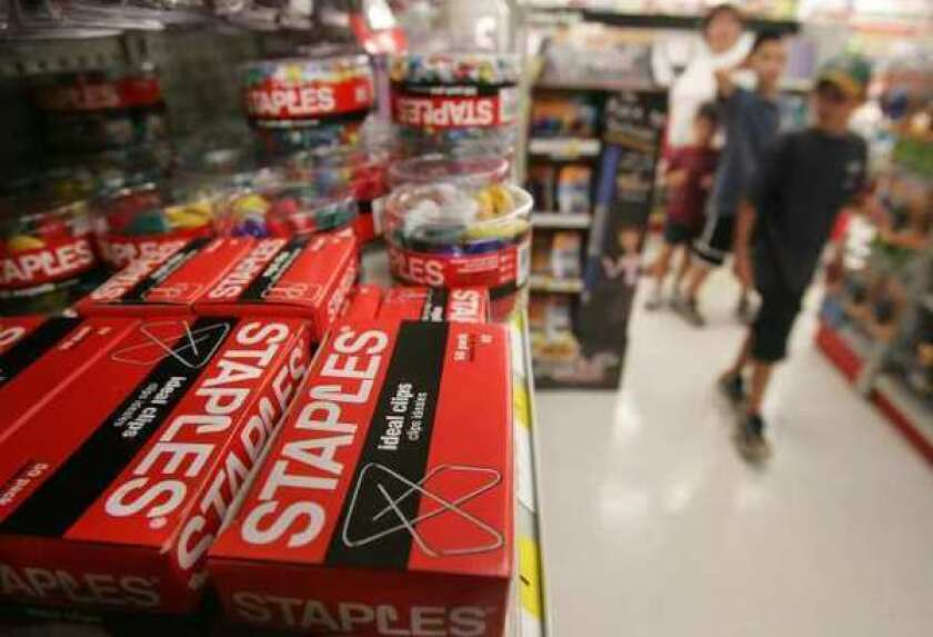 Staples stock jumped after a report that private equity firms, including Bain, were considering a buyout of the company.