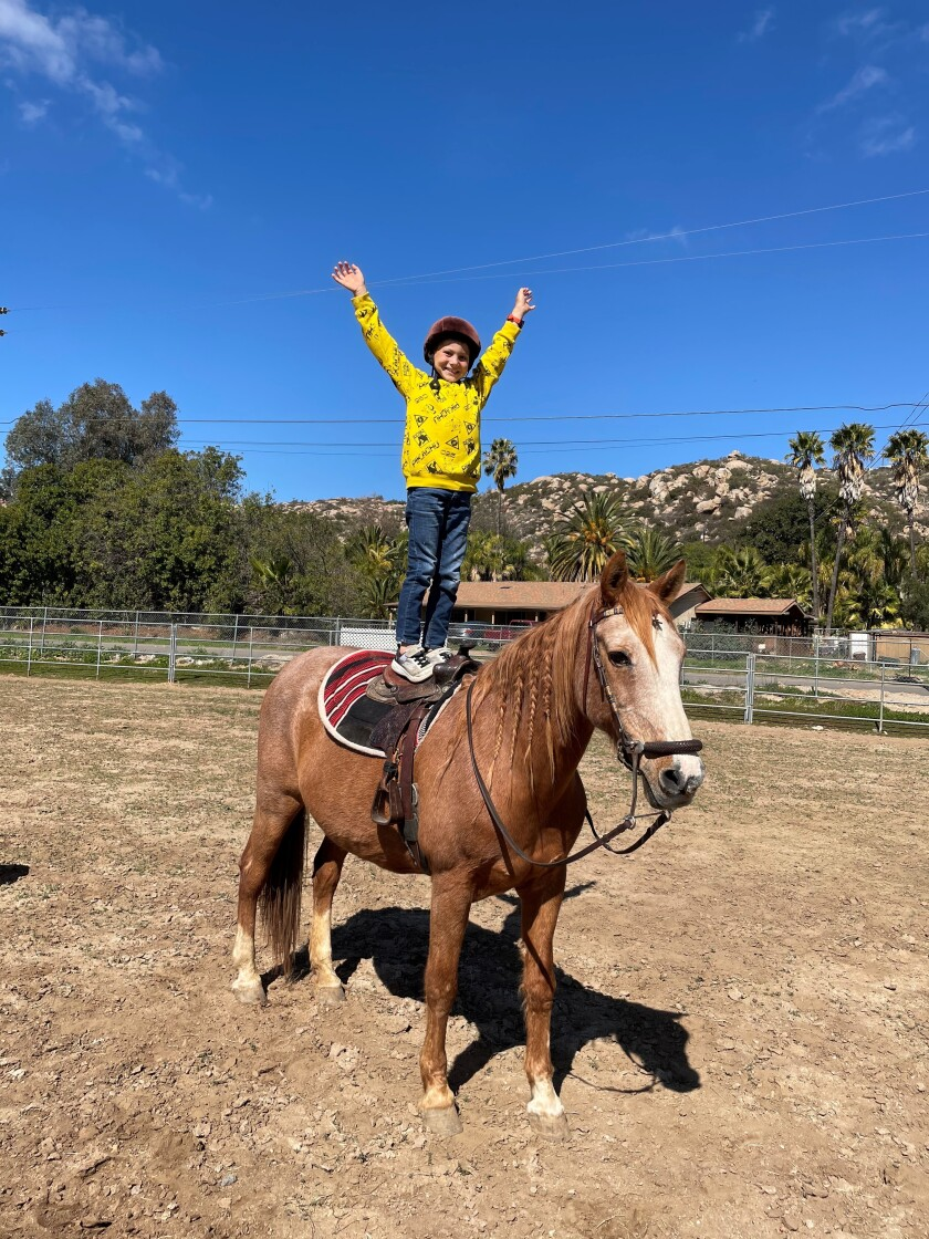 """Mary Meurs sent this photo. """"This is my son, Arie, giving praise to God for Ramona and his horse, Kitty."""""""