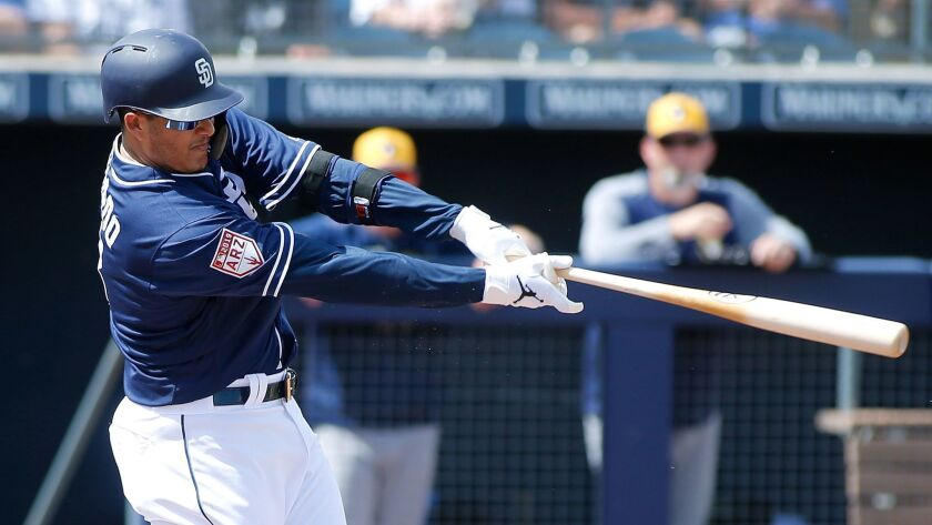 San Diego Padres third baseman Manny Machado swings at a pitch during a game against the Milwaukee Brewers on March 20.