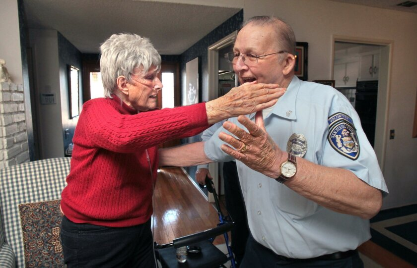 January 26, 2016, San Diego (Rancho Bernardo), California, USA_| 90 year old Dodi Frost hugs San Diego Police Department Retired Senior Volunteer Patrol Officer Dick Abel, at the end of one he and partner Michael Lenth's regular visits to her Rancho Bernardo home. |_Mandatory Photo Credit: Photo by