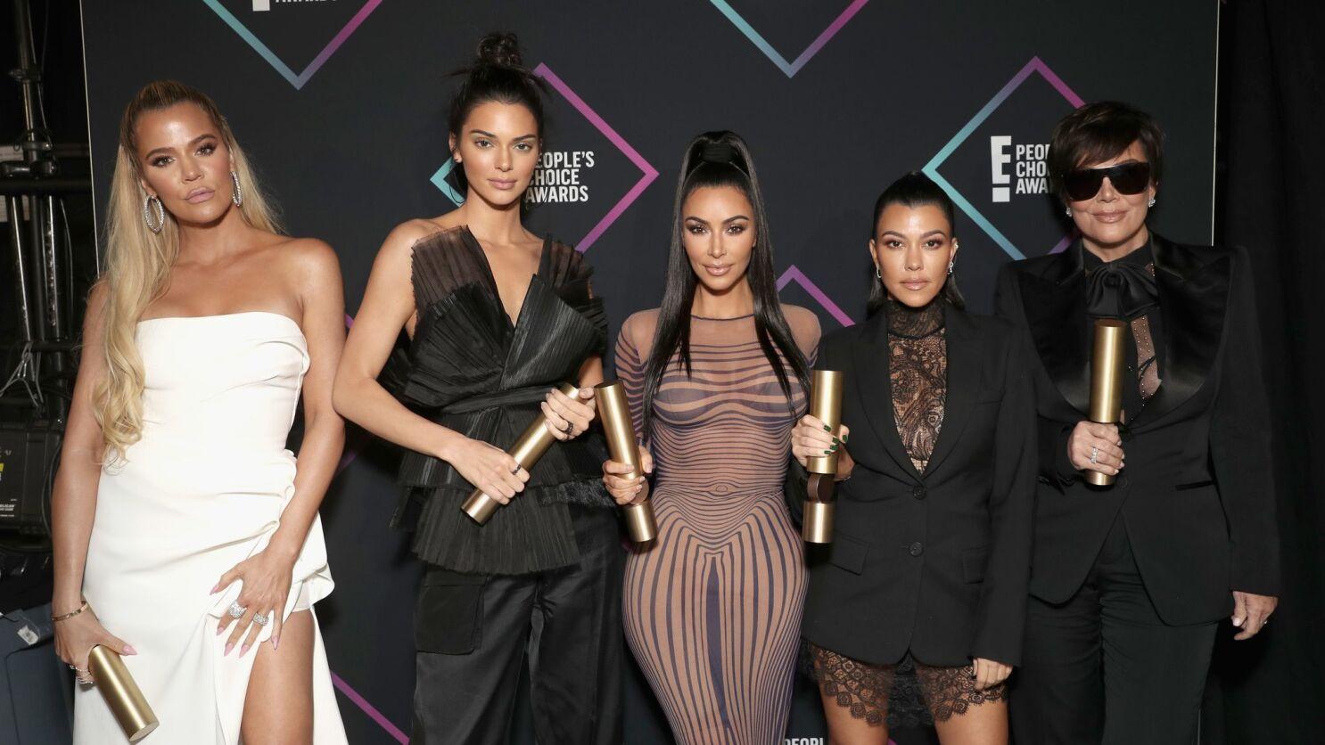 The Kardashian Christmas Card 2021 The Kardashian Jenner Family Unveils Surprise Christmas Photo Card Los Angeles Times