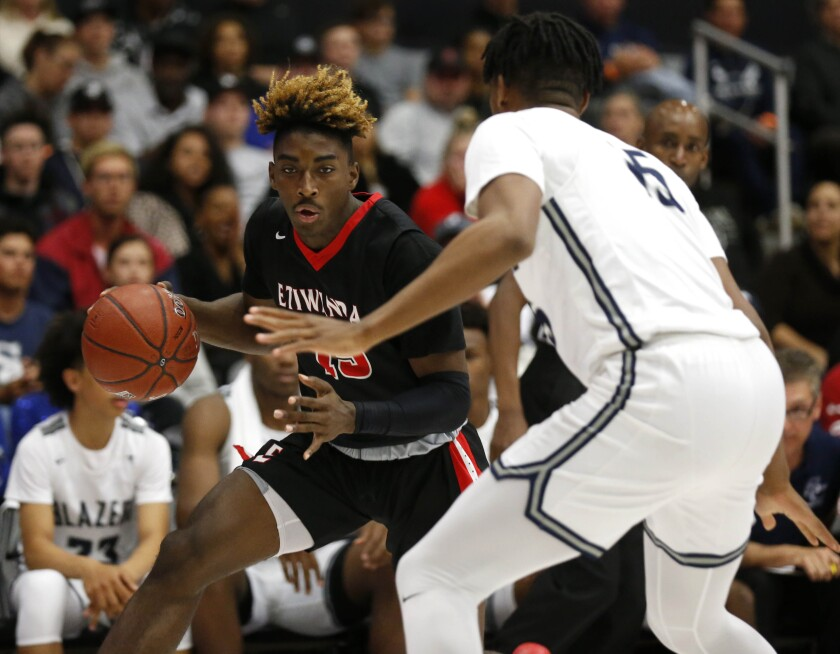 Etiwanda's Jahmai Mashack (15) attempts to drive to the basket guarded by Sierra Canyon's Terren Frank (15) in the first half of the CIF Open Division regional basketball final at the Matadome on the campus of California State University, Northridge on Tuesday.