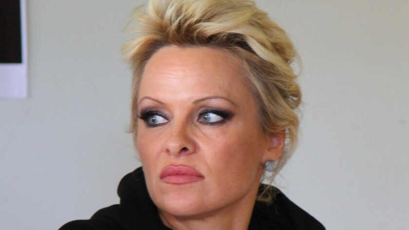 Pamela Anderson, shown at a news conference in the Faeroe Islands in early August, has asked the court to toss her July petition for divorce from Rick Salomon.