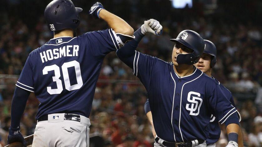 San Diego Padres' Christian Villanueva, right, celebrates his two-run home run against the Arizona D