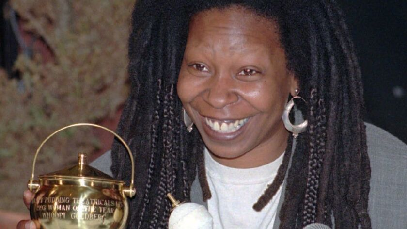 Wrong pot! Comedian Whoopi Goldberg posed in Cambridge, Mass. with the brass pudding pot awarded to her by Harvard University's Hasty Pudding Theatricals, which honored her as its 1993 Woman of the Year.