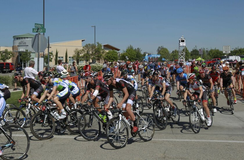 At the beginning of the second stage for the Amgen Tour of California, riders leave the Murrieta Town Hall and head towards Juniper Street as they depart for Palm Springs.
