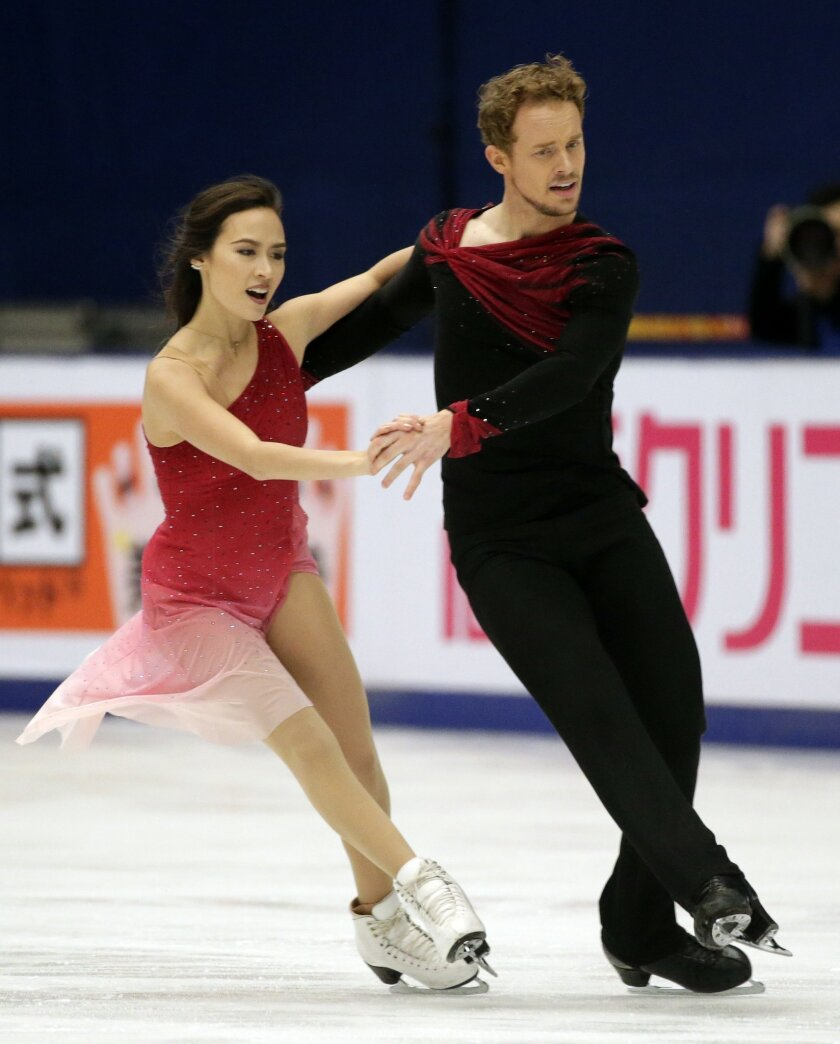 The United States' Madison Chock and Evan Bates compete in the Ice Dance Free Dance program during the ISU Grand Prix of Figure Skating at the Capital Gymnasium in Beijing, China, Saturday, Nov. 7, 2015. (AP Photo/Mark Schiefelbein)
