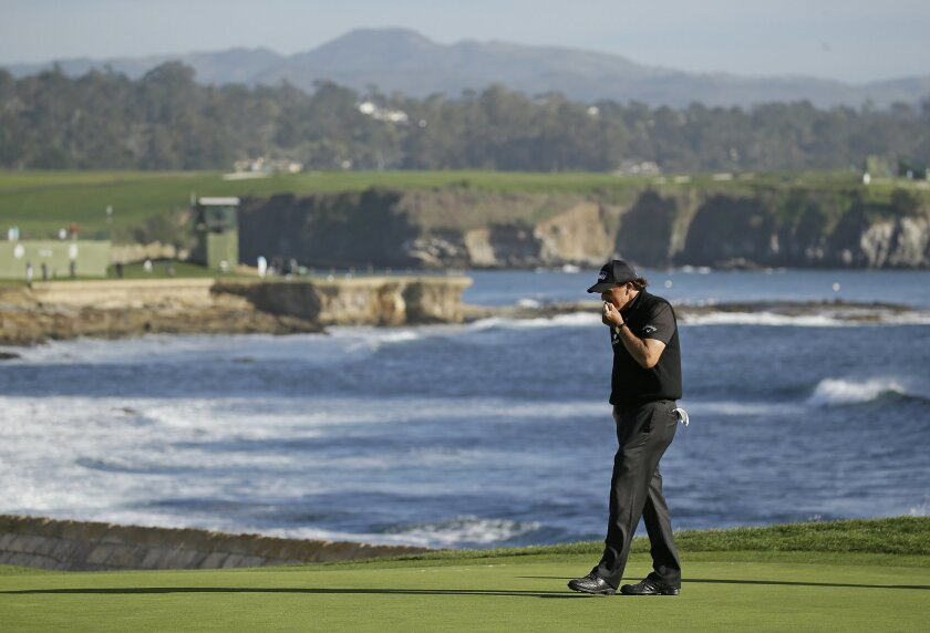 Phil Mickelson reacts after missing a birdie putt on the 18th green of the Pebble Beach Golf Links during the final round of the AT&T Pebble Beach National Pro-Am golf tournament Sunday, Feb. 14, 2016, in Pebble Beach, Calif. Vaughn Taylor won the tournament. (AP Photo/Eric Risberg)