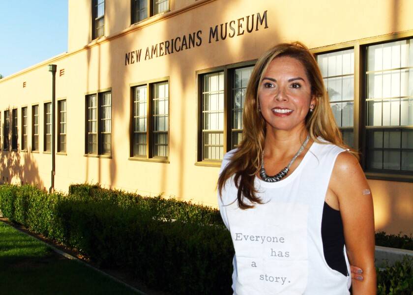 Linda Caballero Sotelo in front of the New Americans Museum