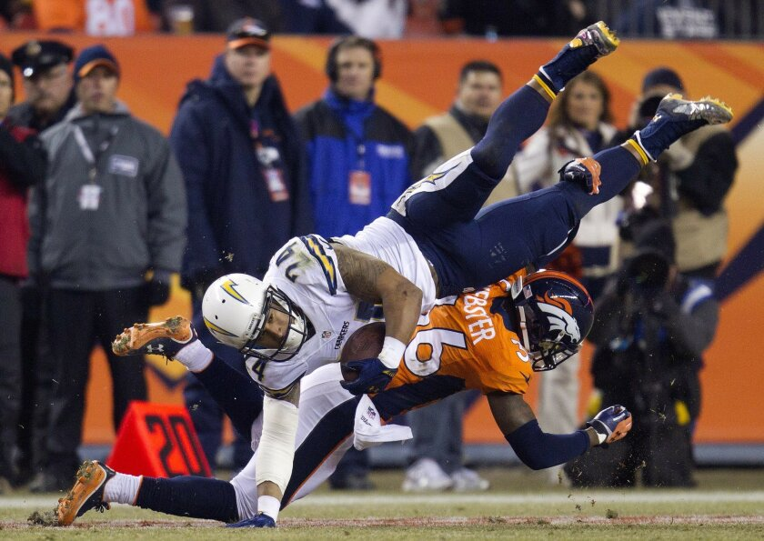 The San Diego Chargers vs. The Denver Broncos at Sports Authority Field in Denver. Ryan Mathews is upended by Kayvon Webster in the third quarter.
