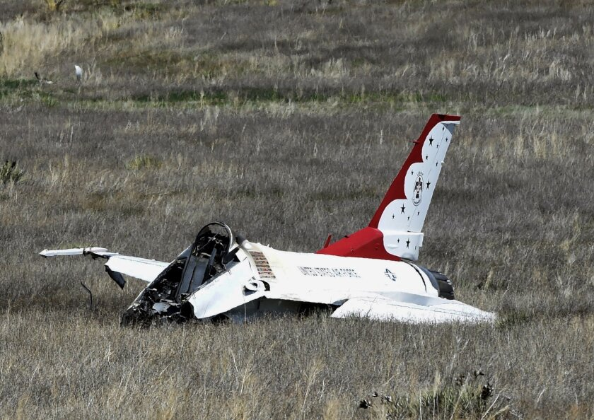 A U.S. Air Force Thunderbird that crashed following a flyover rests on the ground south of the Colorado Springs, Colo., airport after a performance at a commencement for Air Force Academy cadets Thursday, June 2, 2016. The pilot ejected safely from the jet. (Jerilee Bennett/The Gazette via AP) MAGS