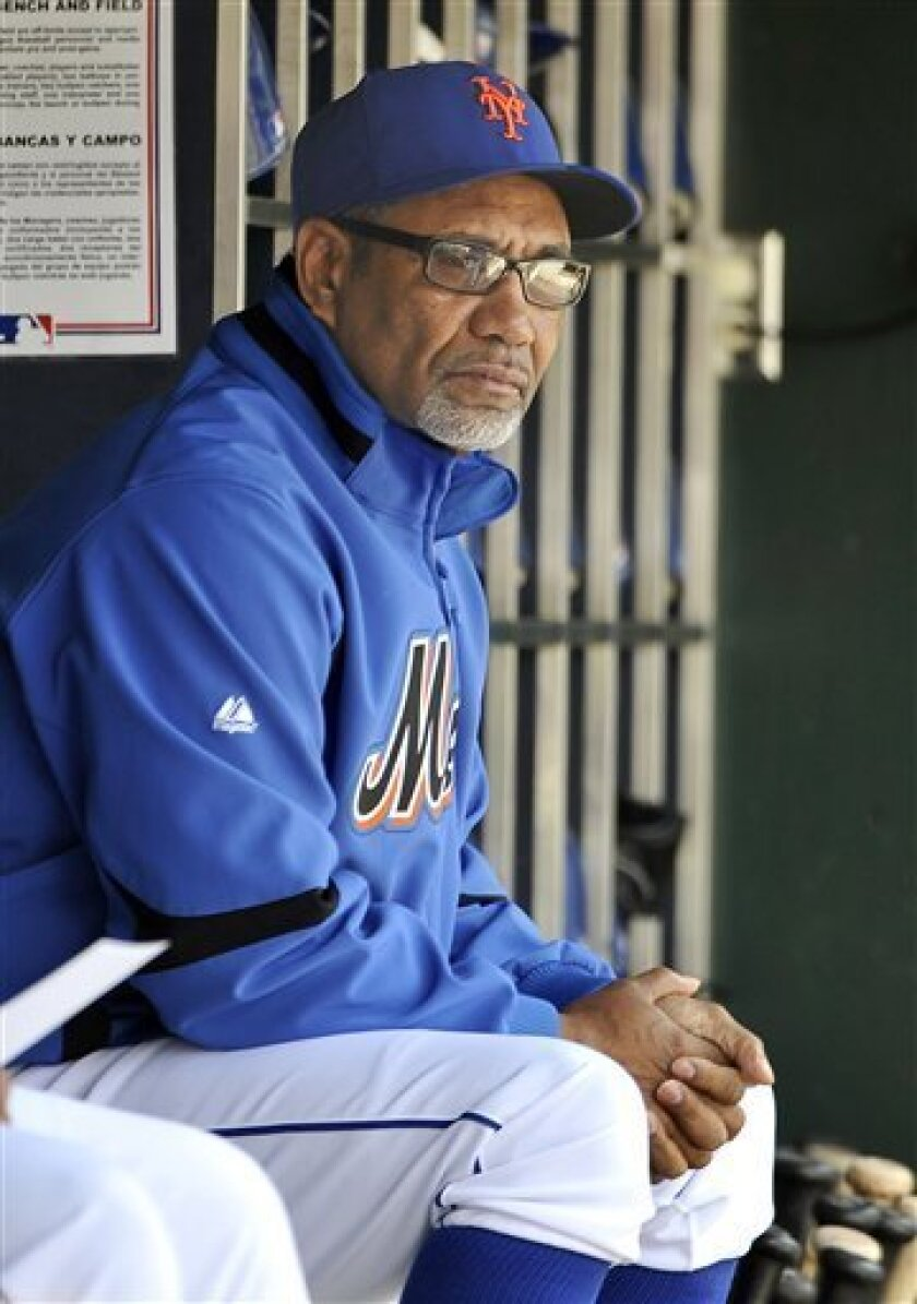 New York Mets manager Jerry Manuel looks on from the dugout before the final baseball game of the season against the Washington Nationals, Sunday, Oct. 3, 2010, in New York. The Nationals won 2-1. (AP Photo/Kathy Kmonicek)