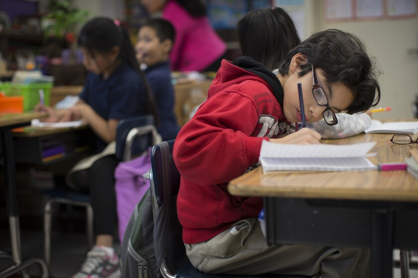 Ramon Hernandez writes in his journal at Gratts Elementary School in Los Angeles.